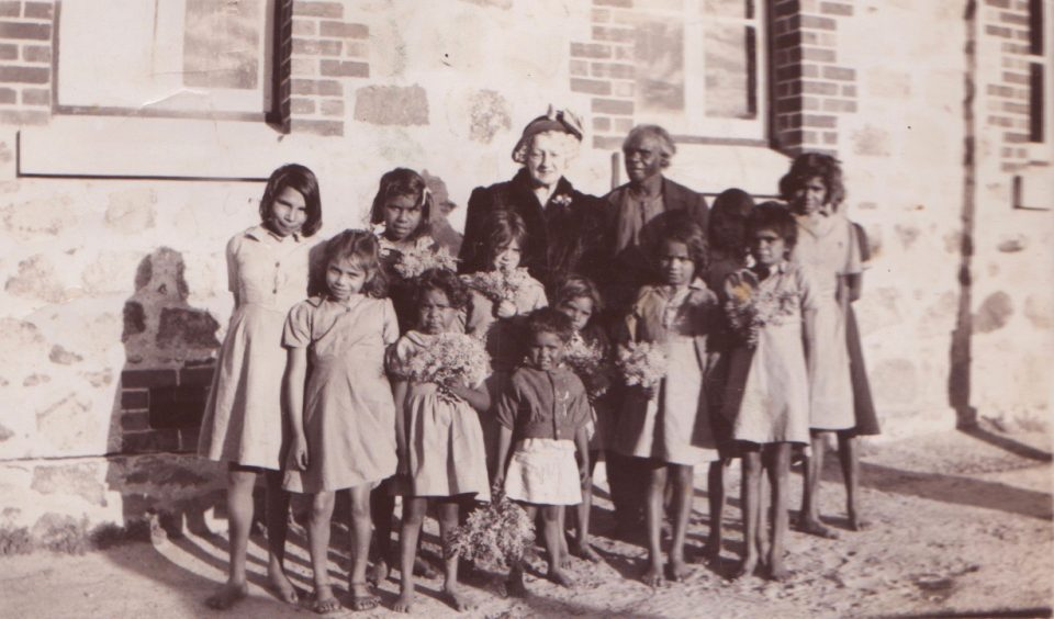 Mrs Rutter with Prince Rudy Dinah and a group of Carrolup girls. The girl second from the left is Mildred Jones. Photographer: Noel White, 31st July 1949. Noel & Lily White Collection.