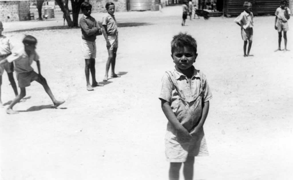 Grady Cuttabit in Carrolup schoolyard. Photographer: Vera Hack, January 1950. Noel & Lily White Collection.