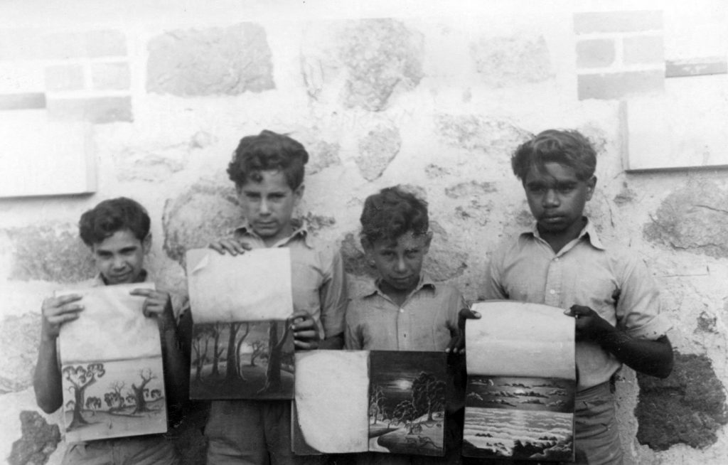 Four unidentified Carrolup boys with their pastel drawing books. Photographer: Vera Hack, January 1950. Noel & Lily White Collection.