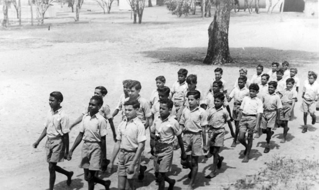 The boys of Carrolup marching for Mrs Rutter and Mrs Hack. Photograph taken by Vera Hack, January 1950.