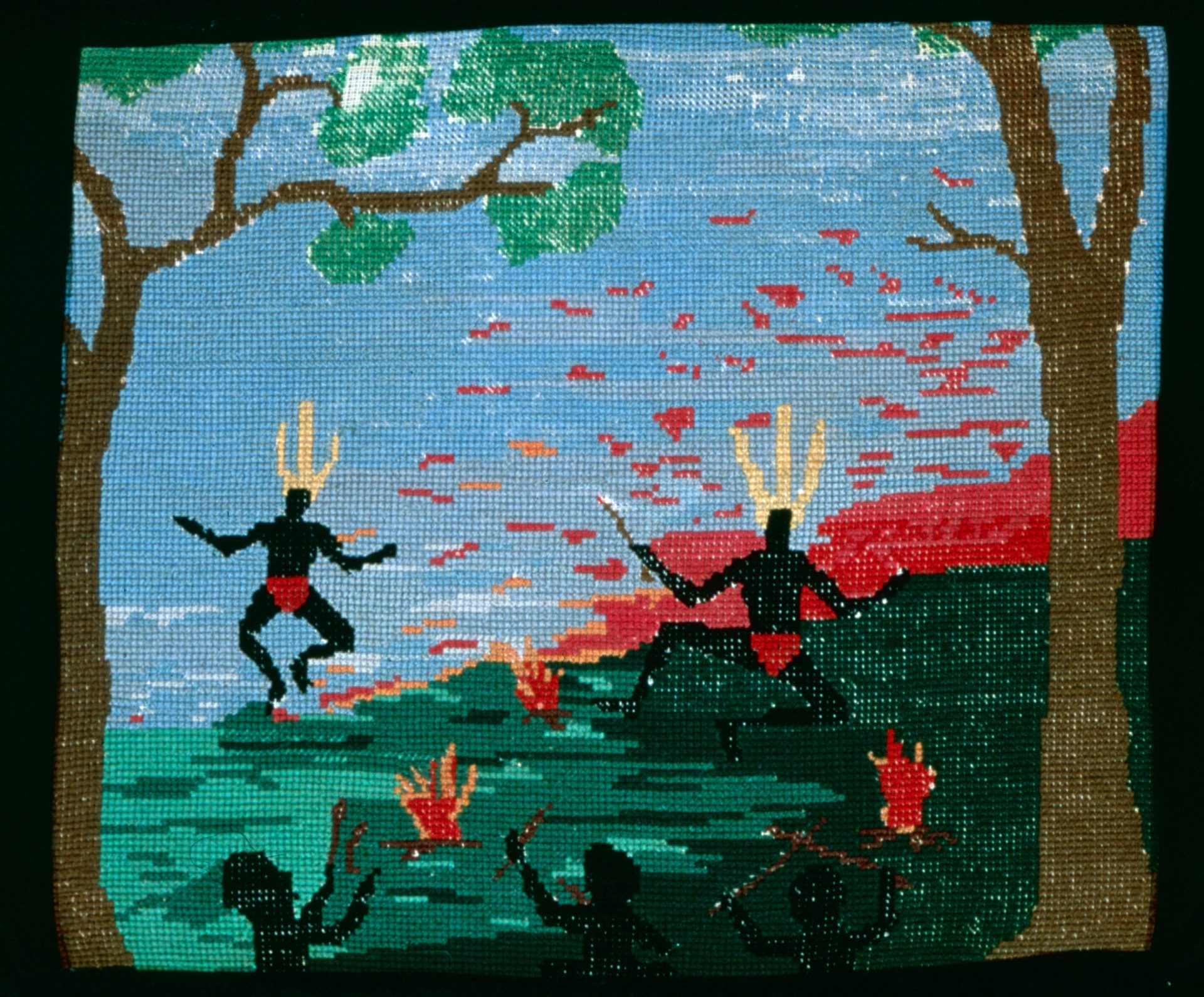 <em> Night Corroboree </em> by Vera Wallam, woollen tapestry on velvet frame, 33 x 40cm, 1948. Noel & Lily White Collection, Berndt Museum of Anthropology.
