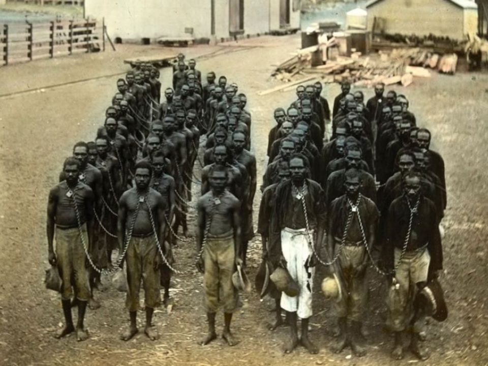 Aboriginal prisoners in neck chains at Wyndham, Northern Western Australia. State Library of Victoria.
