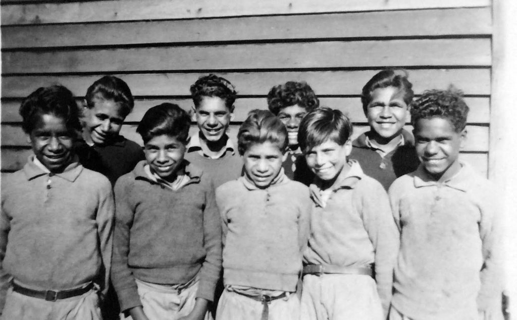 Some of the Carrolup young artists. Front row: Reynold Hart (Far Left), Parnell Dempster (Middle) and Revel Cooper (Far Right). Back row, 2nd Left: Barry Loo. Do you know who the other boys are?