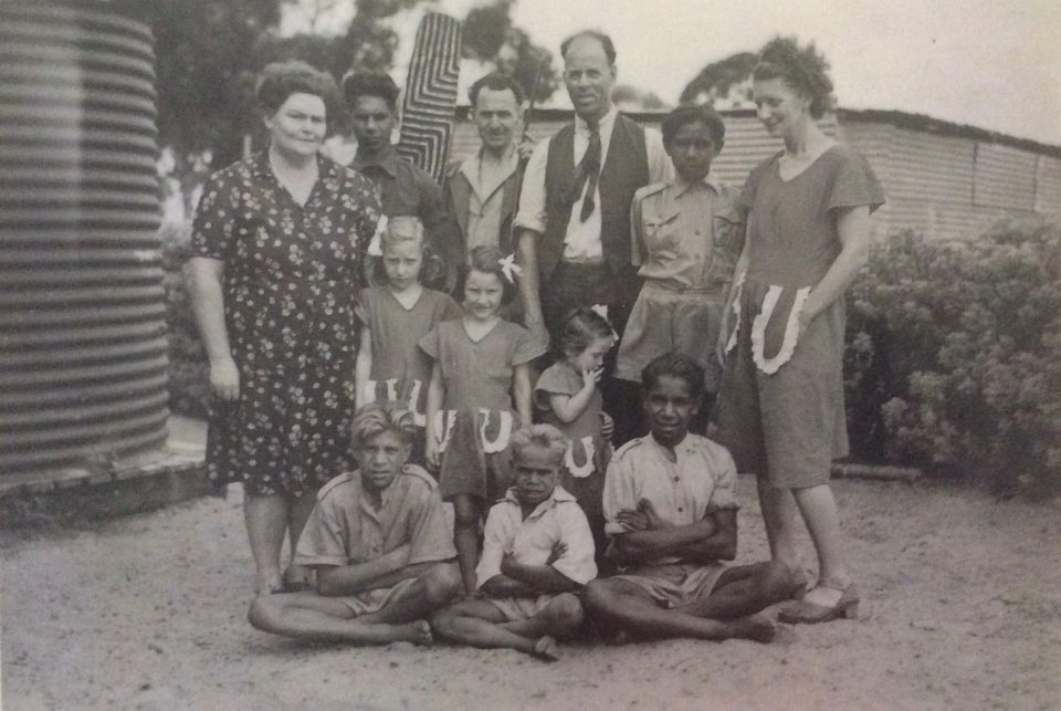 Mr and Mrs White with some of the Carrolup boys and the Peet family. Back row: Barry Loo, Mr. Peet, Noel White, Adrian Allen and Mrs. Peet. Middle row: Lily White and the three Peet girls. Front row: Parnell Dempster, unidentified boy and Reynold Hart. Photograph taken in 1949. Noel & Lily White Collection.