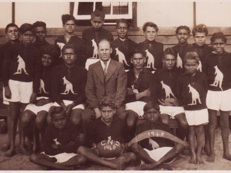 The 1948 Carrolup School football team with their teacher, Noel White.
