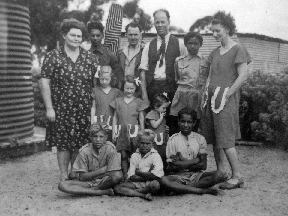 Mr. and Mrs. White with some of the Carrolup boys and the Peet family. Back row: Barry Loo, Mr. Peet, Noel White, Adrian Allen and Mrs. Peet. Middle row: Lily White and the three Peet girls. Front row: Parnell Dempster, unidentified boy and Reynold Hart. Photograph taken in 1949. Noel & Lily White Collection.
