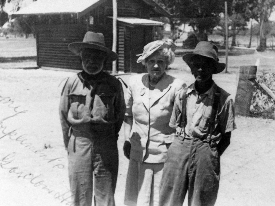 Mrs Rutter with two of the trackers at Carrolup during her second visit. Photographer: Vera Hack, January 1950. Noel & Lily White Collection.