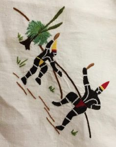 Detail of a large tablecloth embroidered by the Carrolup girls under the supervision of Vera Wallam based on designs by Revel Cooper. It was a Christmas gift from all the girls to Mr and Mrs White, 1948. Noel & Lily White Collection.