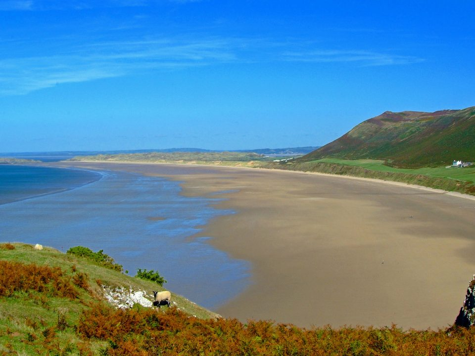 One of my favourite places, Rhossili Beach, Gower Peninsula (my home for 14 years), South Wales, UK. Click on photo for wider panorama.