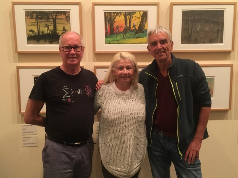 John Stanton (left) and David Clark with Cheryle Jones at the Carrolup Revisited exhibition by the Berndt Museum of Anthropology held in the Lawrence Wilson Art Gallery, The University of Western Australia, 8th June 2019. Cheryle's mother Mildred was at Carrolup School during the time that Noel White was teacher.